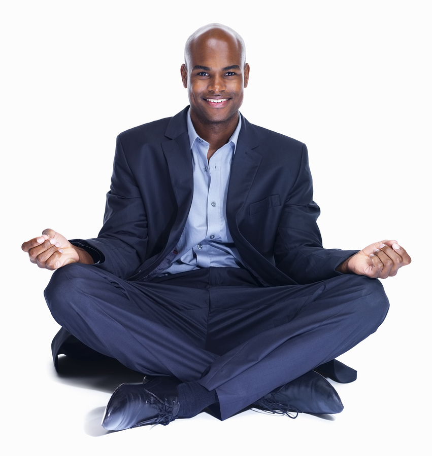 Smiling business man meditating on white