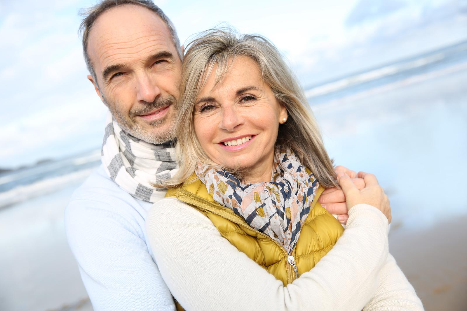 Portrait of loving senior couple at the beach