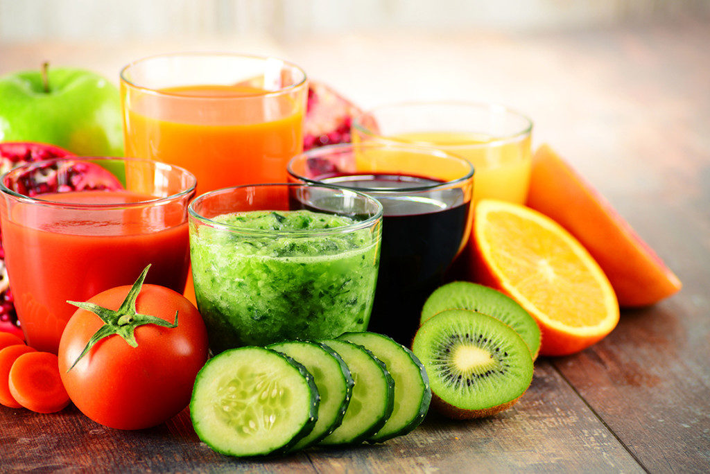 Glasses of fresh organic vegetable and fruit juices. Detox diet. ** Note: Shallow depth of field